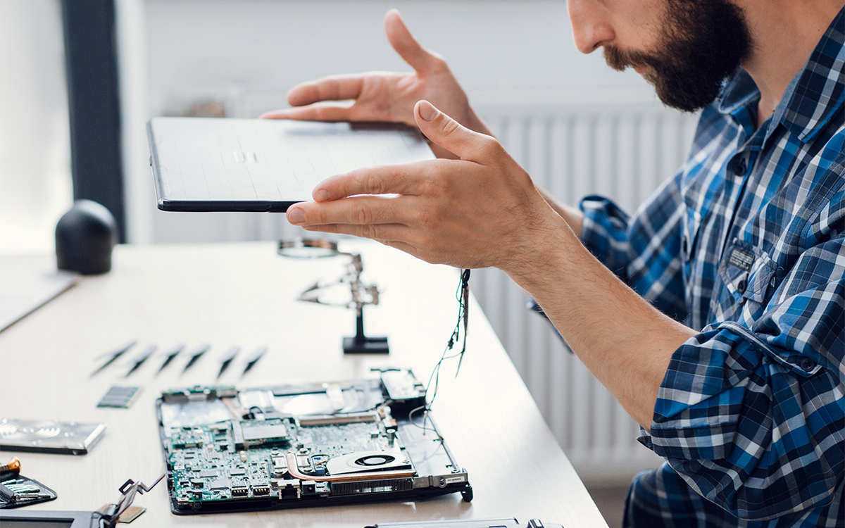 Disassembled laptop being repaired