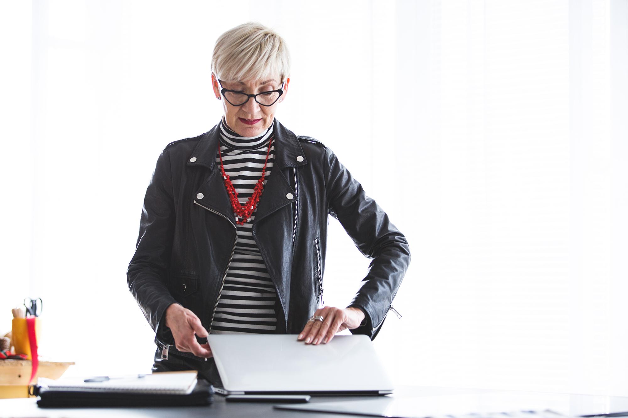 Woman opening laptop