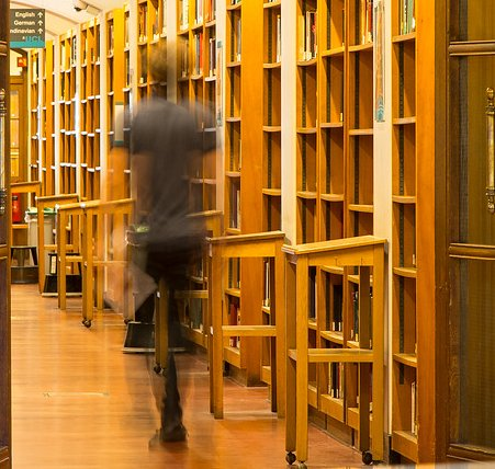 Person walking through library hallway