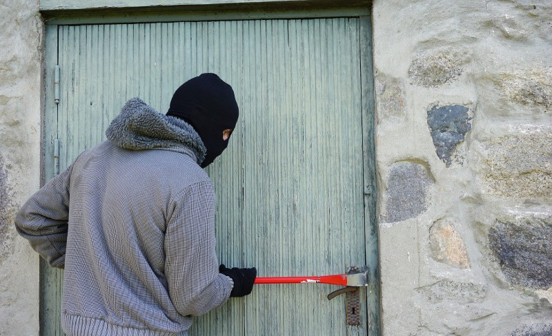 Man breaking into a door