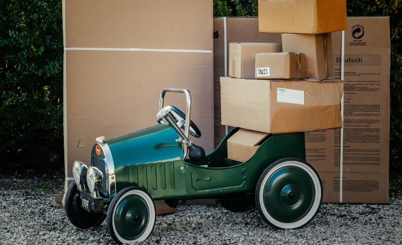 a green car with packages around it