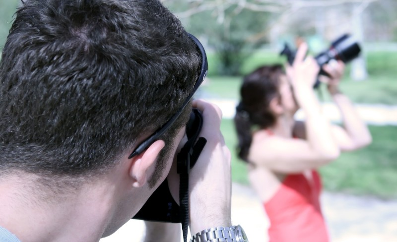 May taking photo of woman taking a photo 2