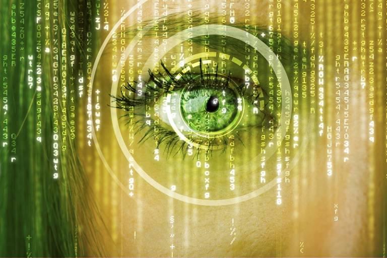 Human eye with computer code overlaying the image