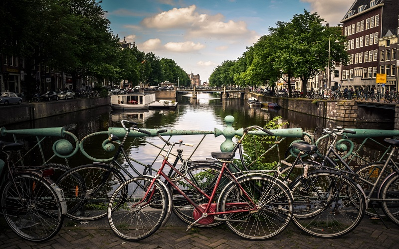 Dutch - bikes by the river in Amsterdam