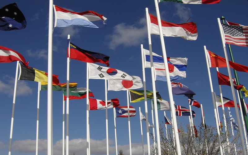 International students: flags from a range of different countries blowing in the wind