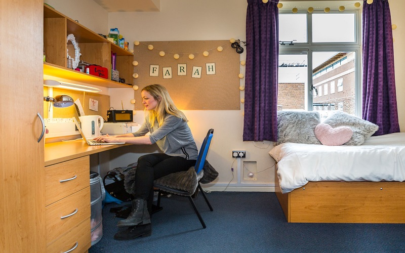 Student on their laptop in their accommodation/room