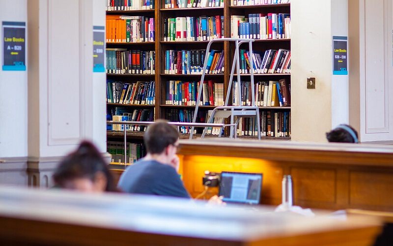 Students working in the Law library