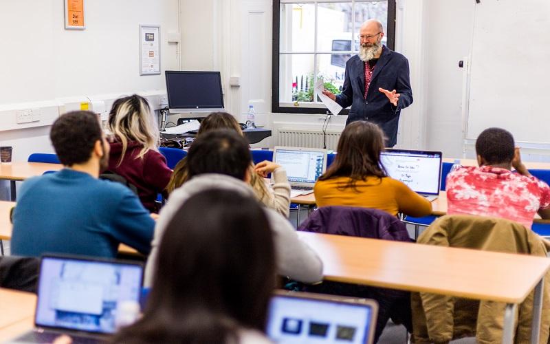 UCL international foundation students listening to a teacher speak in a seminar