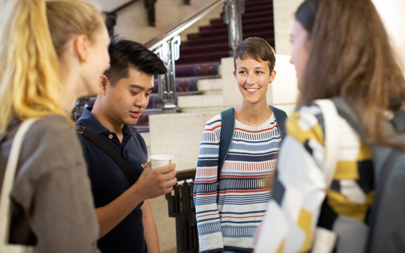 Four students talking to one another at the UCL Laws LLM induction 2019