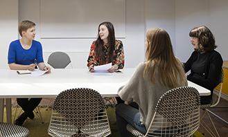Image of people sitting around a table at UCL Laws