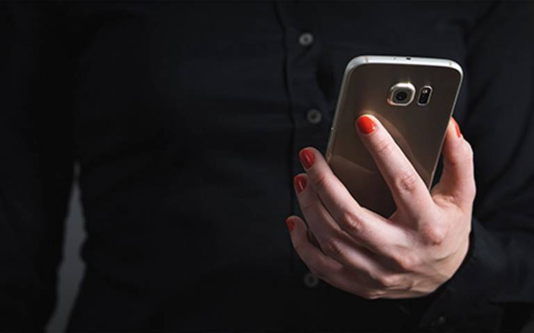 Image of person holding a mobile phone