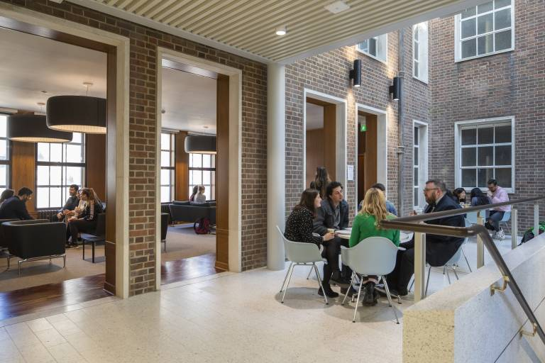 Image of students and staff talking in the Hub