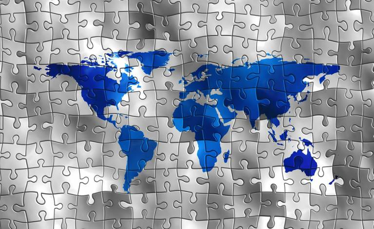 image of the world in jigsaw puzzle format