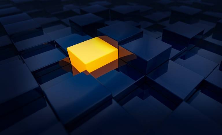 Image of a yellow cube amongst dark blue cubes