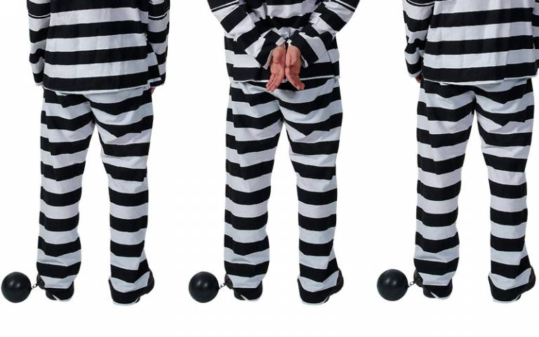 prisoners in stripy clothing, with ball and chain on ankles