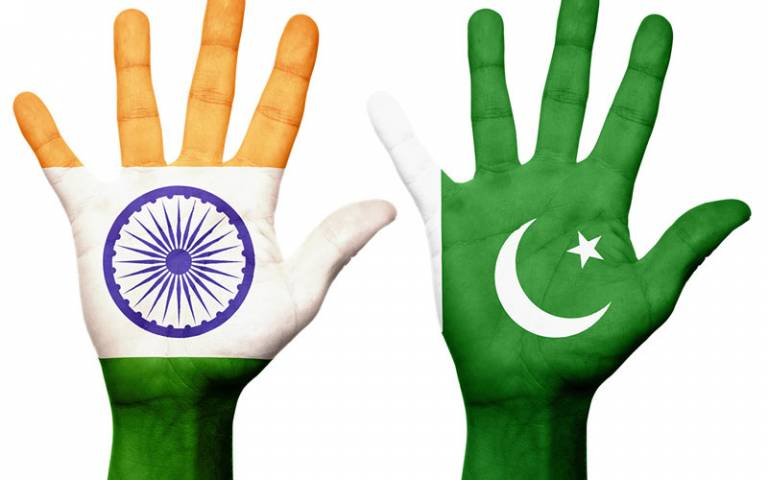 India and Pakistani flags on hands