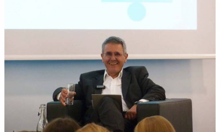 Professor Sir Robin Jacob sitting on an armchair at an event