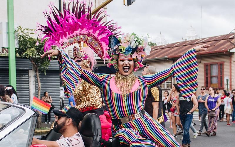 Person at a Pride march, photo by Ashly Araya, Unsplash
