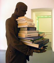 Statue with books