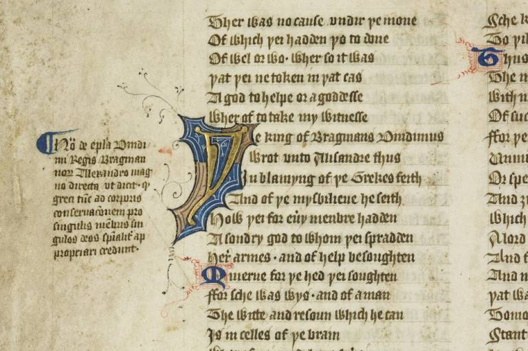 A close up of a Middle English manuscript.  Deep blue and gold decorates black gothic writing.