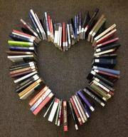 Books laid out in a heart shape
