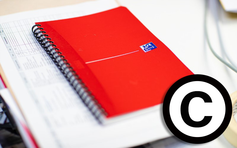Notepad and paper with copyright icon added
