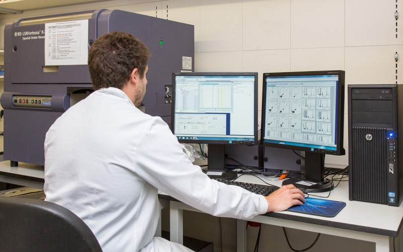 NHS researcher looking at computer screen