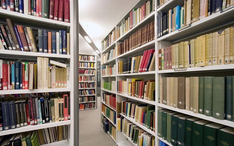 Books on shelves inside SSEES Library