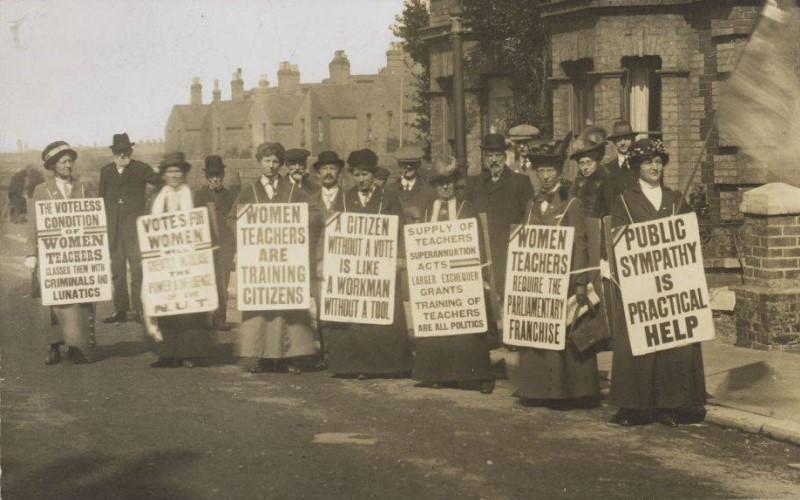 Archive photo: suffragists holding banners. Taken from one of our past exhibitions.