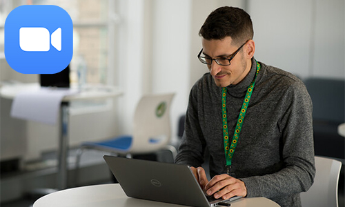 Student using laptop with the Zoom icon overlaid