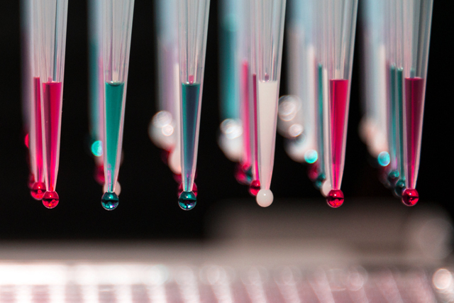 Closeup of coloured drops - High content biology laboratory equipment