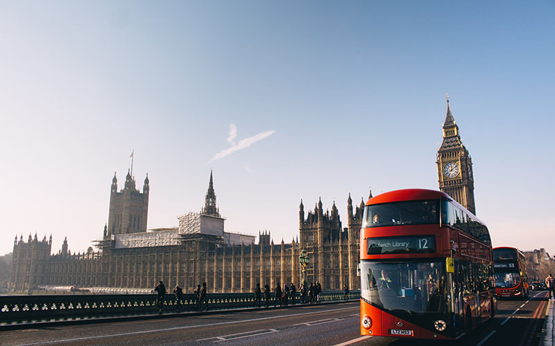 Photo of the Houses of Parliament and a red London bus