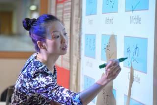 teacher writing Mandarin on a whiteboard