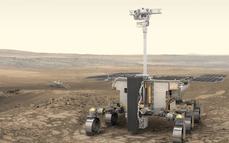 "Artist's impression of ESA's ExoMars rover (foreground) and Russia's science platform (background) on Mars. The PanCam, or ""eyes"" of the rover, is placed at the top of the mast and was developed by a dedicated team of scientists and engineers at the UCL M"