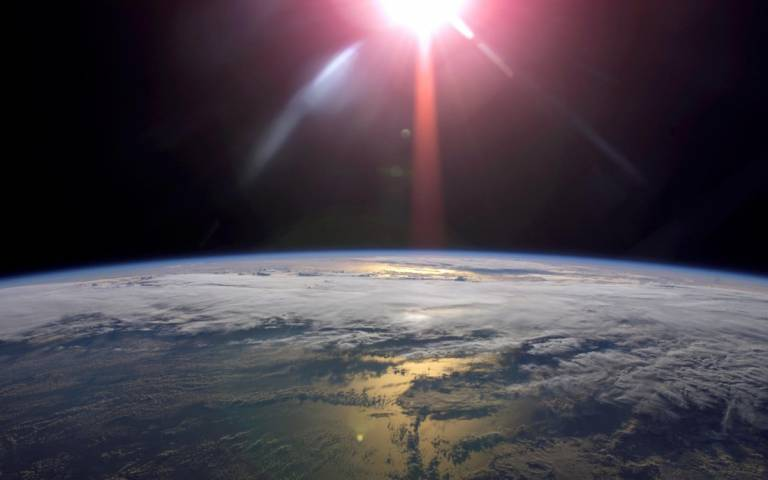 Image of the earth, showing the stratosphere and sun
