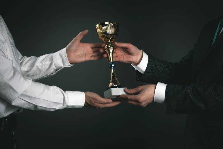 Image of trophy being given to prize-winner