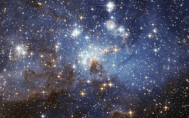 A European Space Agency image, taken using the Hubble Space Telescope, featuring the LH 95 star forming region of the Large Magellanic Cloud.