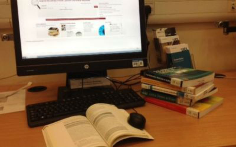 Images of a PC and books