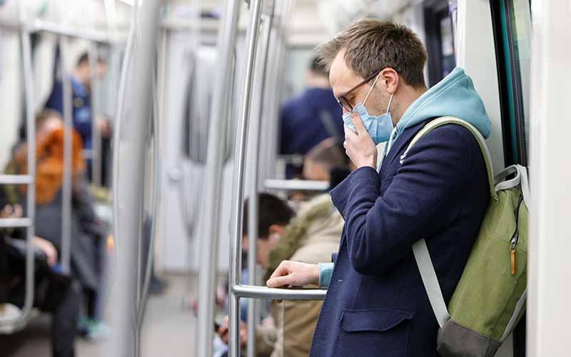 man on tube wearing mask