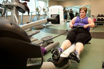 Woman exercising on a rowing machine
