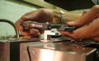 Checking machined parts with a micrometer