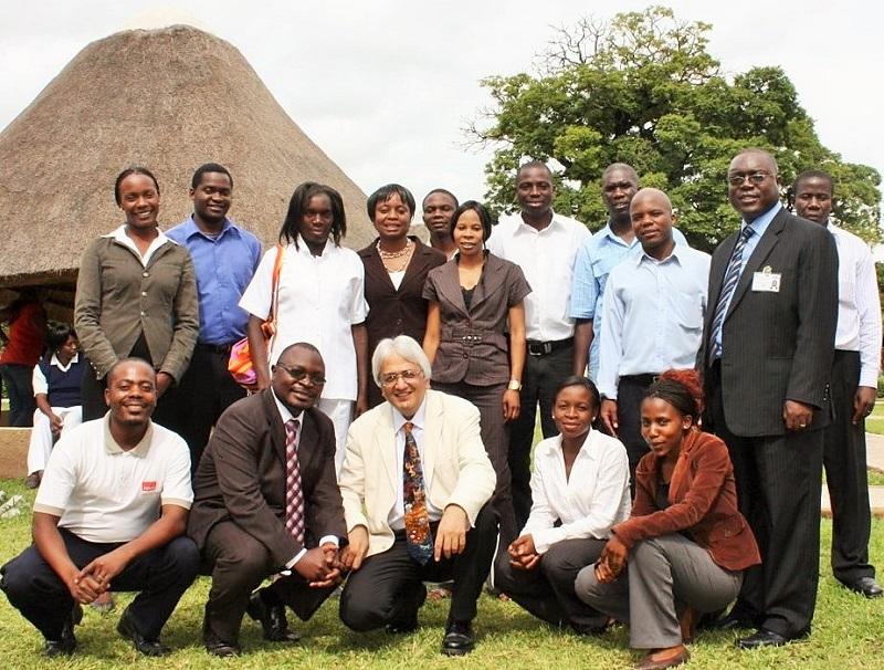 Professor Alimuddin Zumla (centre) with the Zambia research staff