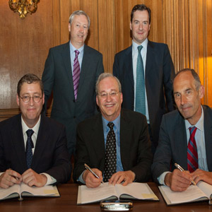 The signing: (standing from left) Martin Curley, VP and Director Intel Labs Europe; Rt Hon George Osborne, UK Chancellor of the Exchequer,  and seated, Professor Stephen Caddick, Vice-Provost (Enterprise) UCL; Dr Justin Rattner, CTO, Vice-President …