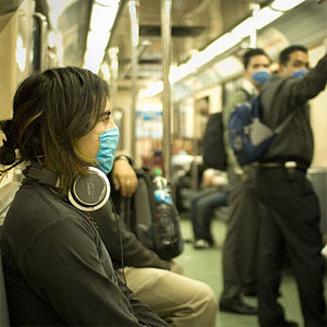 Masked train passengers in Mexico City during 2009 Swine Flu outbreak