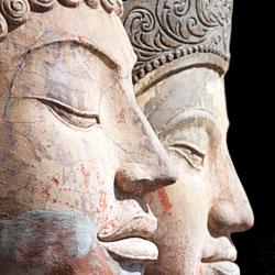 Two buddha heads