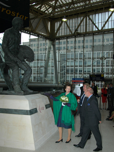 The Princess Royal and sculptor Philip Jackson unveil the sculpture of artist Terence Cuneo at London's Waterloo station
