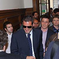 Cristiano Lucarelli enters the lecture theatre