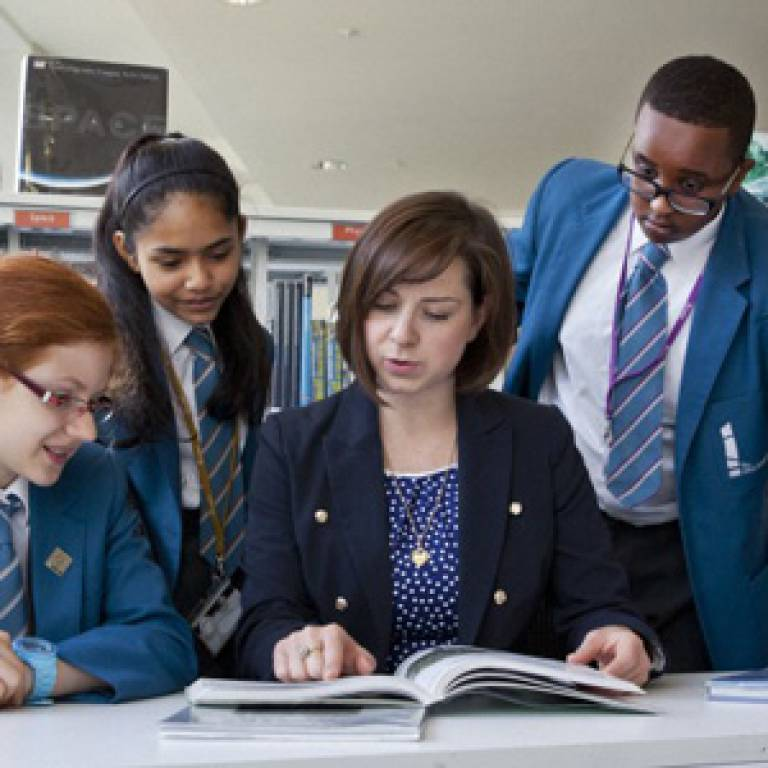 Paula Kearney, UCL Academy teacher, talking to pupils (from left to right) Patricia Markauskaite, Enaya Ali and Haroon Hussein (credit: Wellcome Trust)