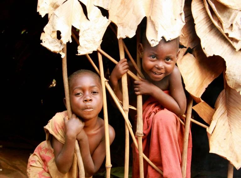 BaYaka children in their hut