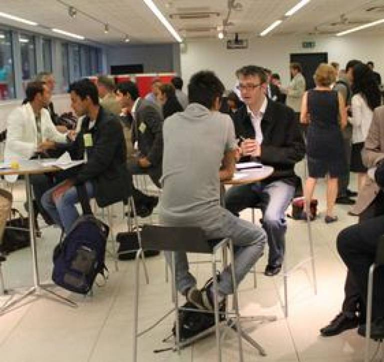 Preople networking at a conference